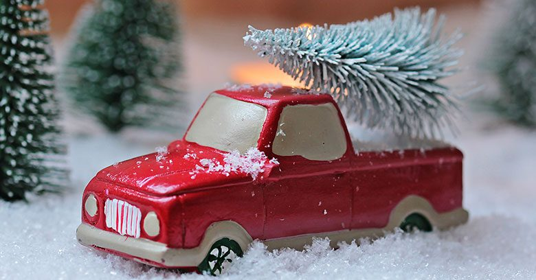 Toy truck carrying a Christmas tree